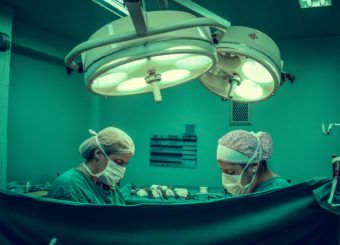 two-person-doing-surgery-inside-room-1250655